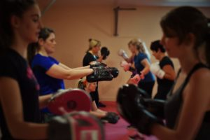 women exercising at a kicking and boxing class with pads and gloves at focus fitness centre elgin